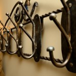 Picture of details of wrought steel coat rack made by Jim Davis.