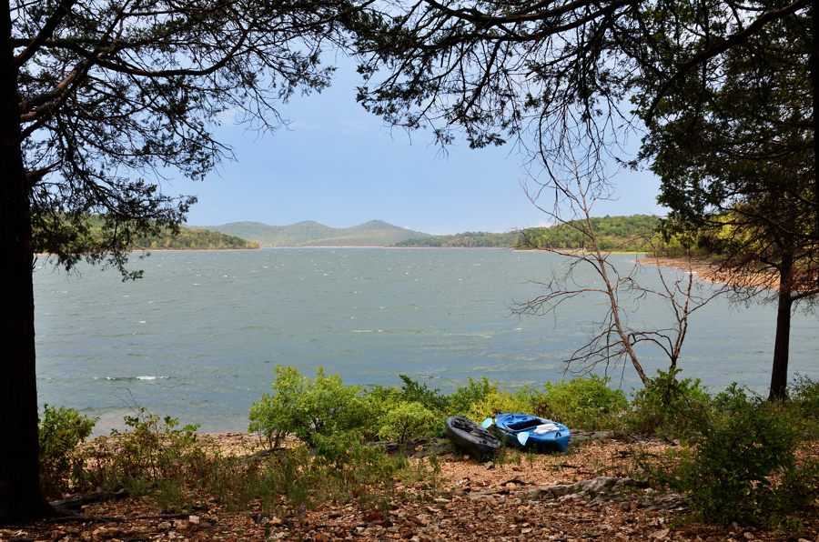 Picture of kayaks near the shore of a stormy Table Rock Lake with whitecap waves on the water.