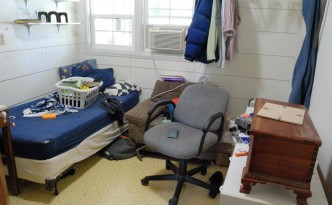 Picture of messy bedroom showing the mess left behind after teen son moved out.