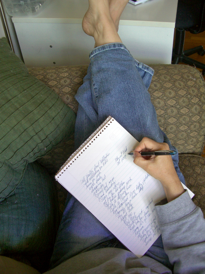 Image of woman writing her to-list for the day.