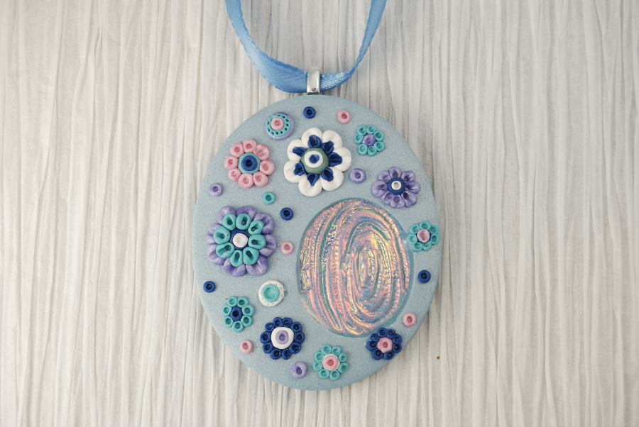 Frost flowers pendant the blue bottle tree blue pendant with flowers made from polymer clay and featuring a holographic effect inset aloadofball Image collections