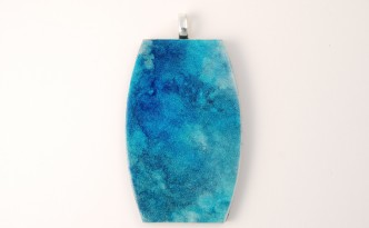 Polymer clay pendant with billowy turquoise and blue colors made with alcohol inks.
