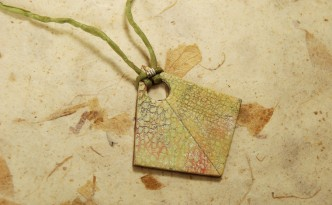 Green crackle polymer clay textured necklace.