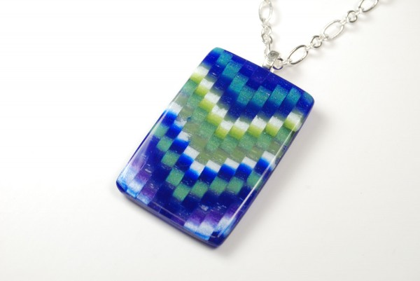 Polymer clay pendant made in the flame bargello effect.