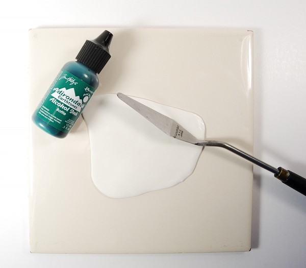 Learn how to color translucent polymer clay with alcohol ink. Article by The Blue Bottle Tree.