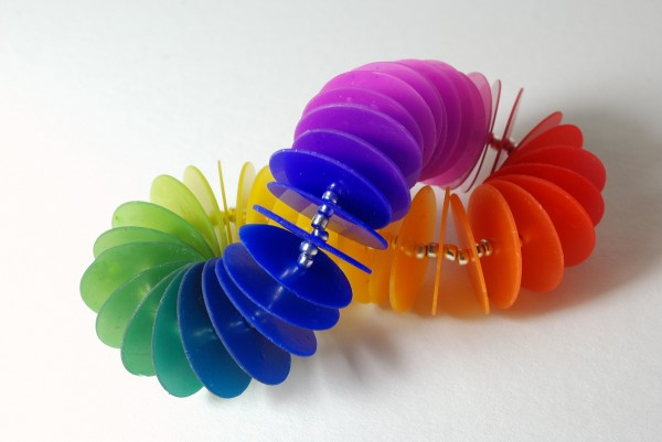 Rainbow gradient disk bracelet made from Fimo polymer clay tinted with alcohol inks.