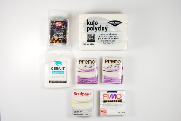Packages of various brands of translucent polymer clay.