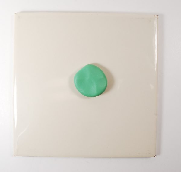 Alcohol ink has been used to tint this green lump of polymer clay.