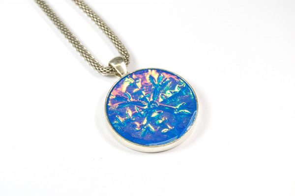 Blue snowflake holographic pendant made from polymer clay with the Holo Effect Tutorial by The Blue Bottle Tree.