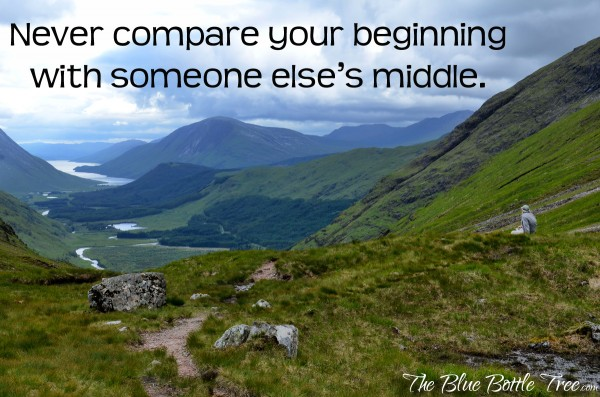 Scottish mountains with motivational saying, Never compare your beginning with someone else's middle.