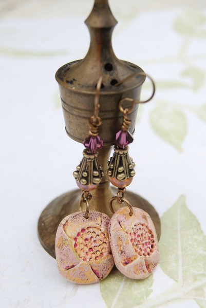 Earrings made with peachy colored Rustic Components.