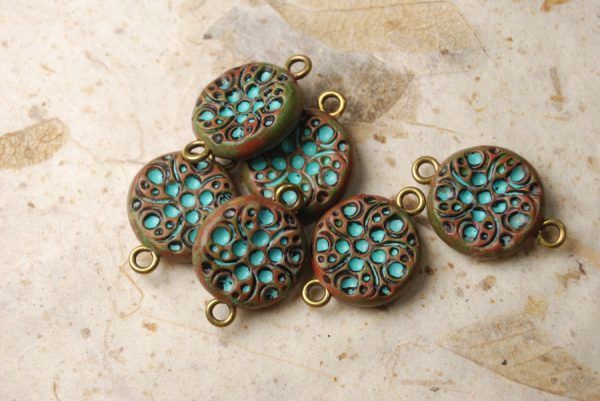 Set of six rustic polymer clay components with turquoise bubble patterns.