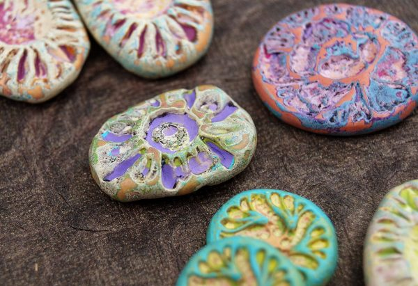 Rustic bead made from polymer clay in spring colors.