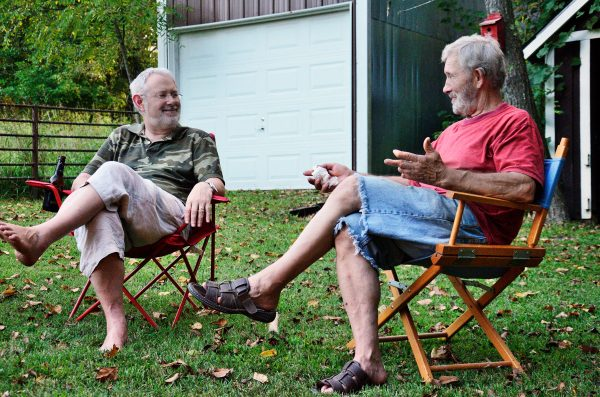 Gary Allman and Jim Davis enjoy good conversation around a fire during Labor Day weekend.