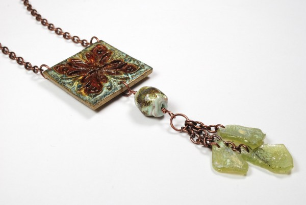 Necklace created with a polymer clay pendant , a glass bead by Numinosity Beads, and faux Roman glass by The Blue Bottle Tree.