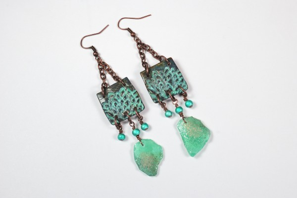 Earrings created from polymer clay using patina paints and faux Roman glass by The Blue Bottle Tree.