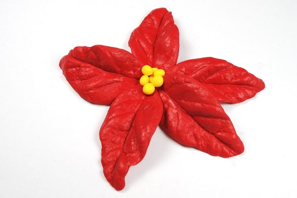 Review of Patchy Molds at The Blue Bottle Tree. Polymer clay poinsettia flower made with Patchy Molds.