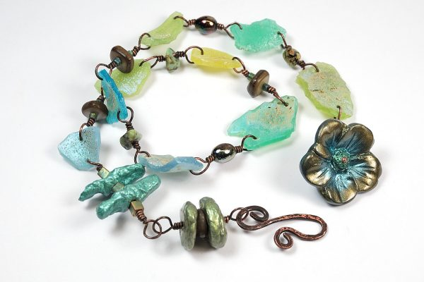 Polymer clay was used to make the faux Roman glass and Biwa pearls in the double wrap bracelet by The Blue Bottle Tree.