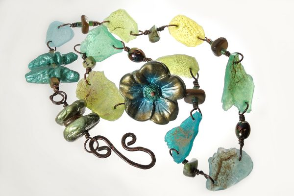 Translucent polymer clay is used to make faux Roman Glass by The Blue Bottle Tree.