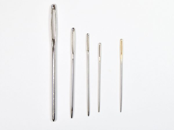 Various sizes of needles used to make needle tools.