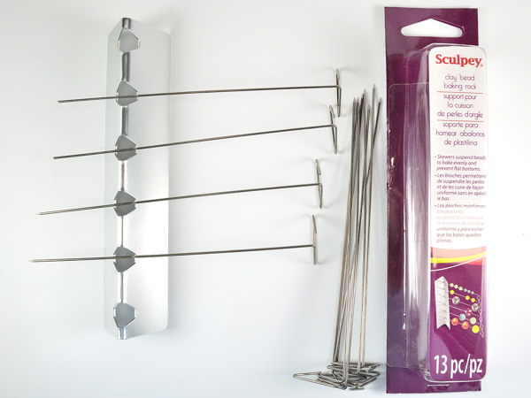 The Sculpey bead baking rack features pins that work well to pierce bead holes.