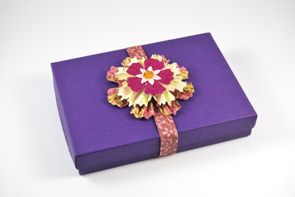 Purple box with cut paper ribbon and bow from Jean A Wells.
