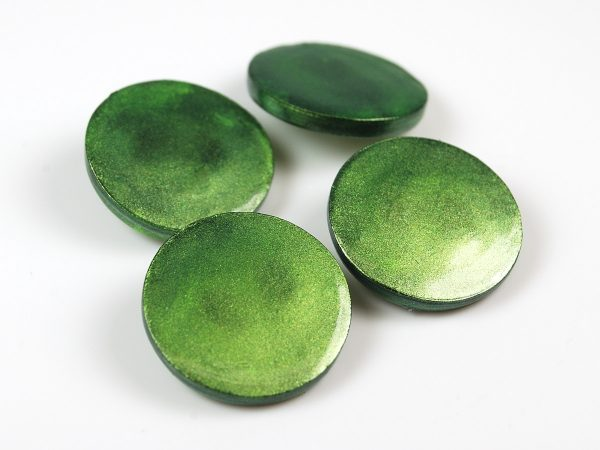 Shank backed polymer clay buttons colored with mica powder.