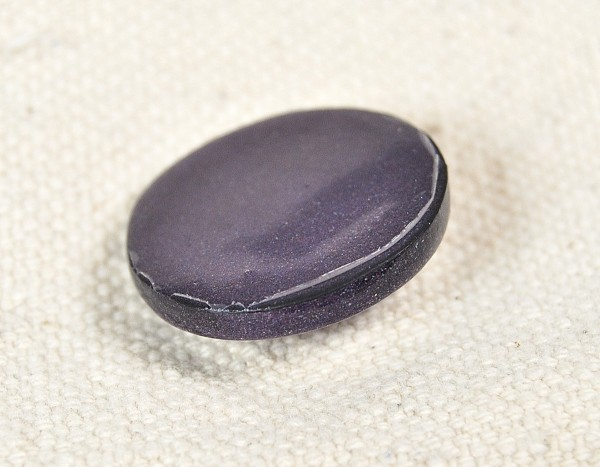 After 40 washes, we're starting to seem some wear and peeling of the varathane from the polymer clay buttons.