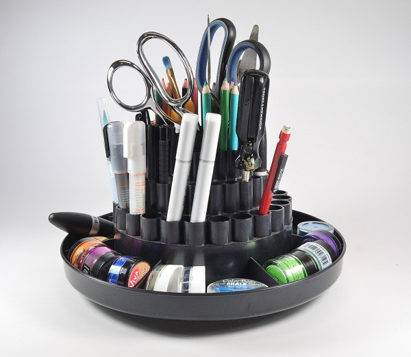 Garage sales are a great place to find office and craft supplies. I found this rotating pen holder for a mere 50 cents.
