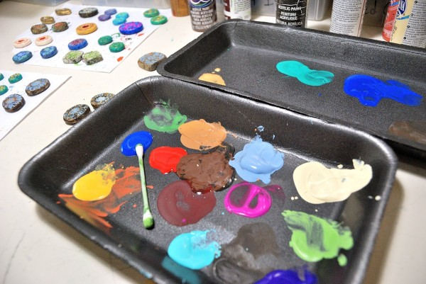 Paint in styrofoam trays that are used as disposable palettes.