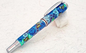 Blue Flowered polymer clay covered pen by Toni Ransfield.