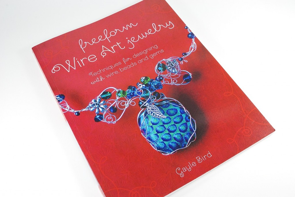 Freeform Wire Art Jewelry by Gayle Bird is a perfect book to introduce non-jewelry crafters to learning simple ways to create finished projects with their polymer clay beads and cabochons. Read the review at The Blue Bottle Tree.