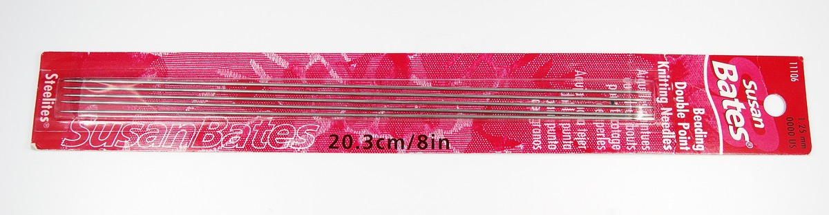 You can use 0000 double pointed knitting needles as bead pins for use in LC Baker polymer clay bead baking rack by Lucy Tools.