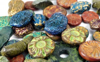 Rich colors of organic and rustic beads made from polymer clay by Ginger Davis Allman. Tutorial available.