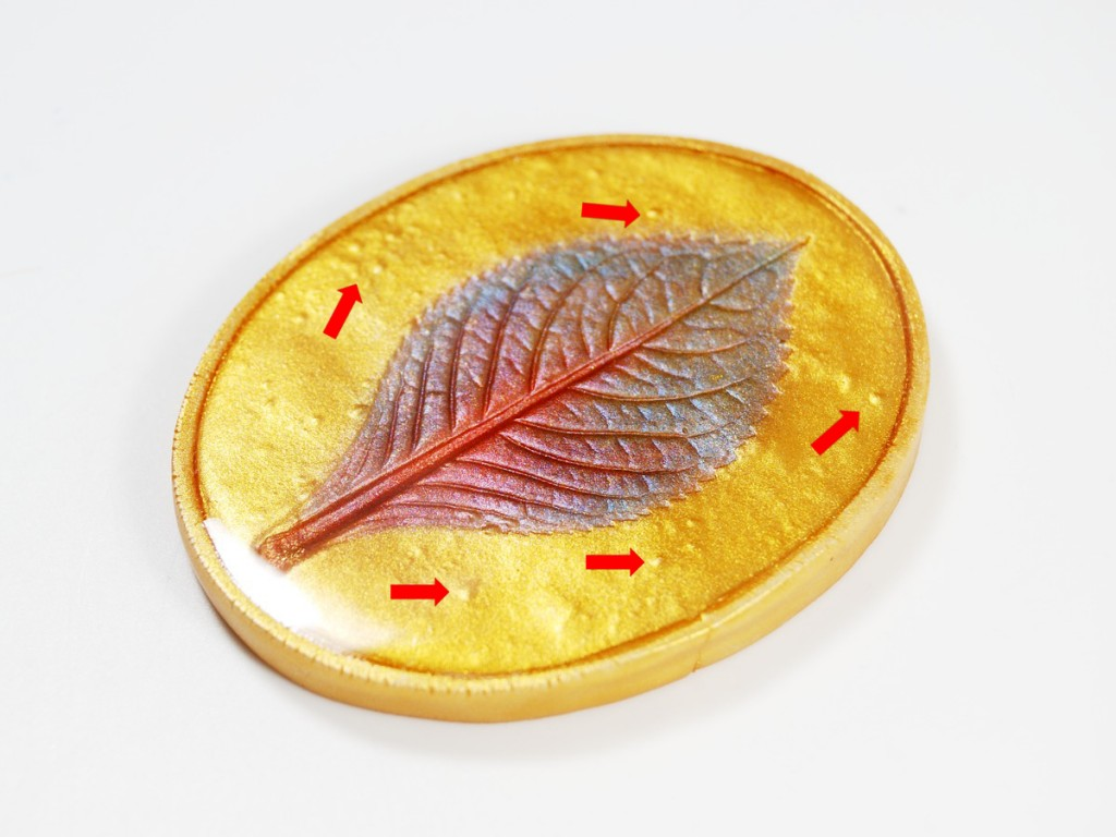 "Polymer clay is known for having ""the bumpies"" after baking, which you can see in this mica leaf pendant."