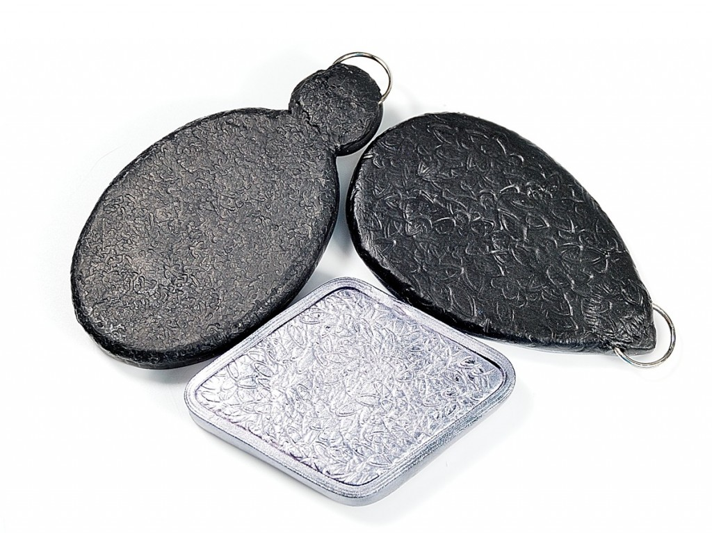 These pendant backs have texture to disguise flaws in polymer clay.