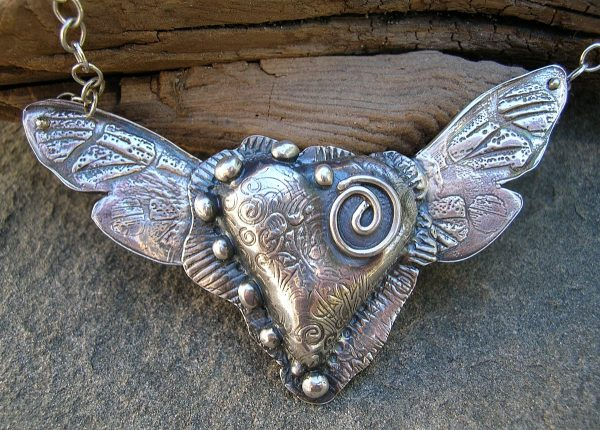 Staci Louise heart with wings necklace