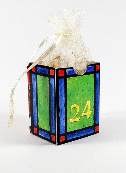 Advent calendar box with gift for Christmas Eve.