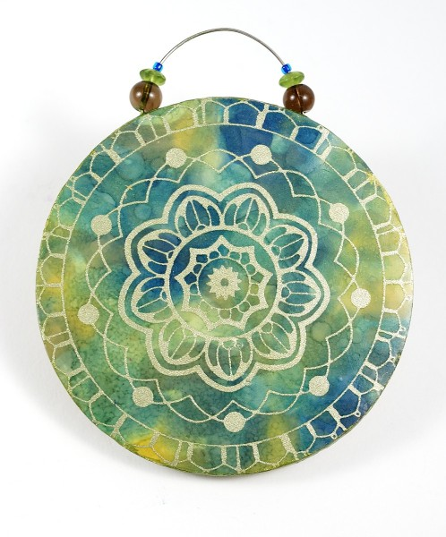 Using alcohol inks with polymer clay, you can color the surface of the clay as in this Opulent Tapestry ornament.