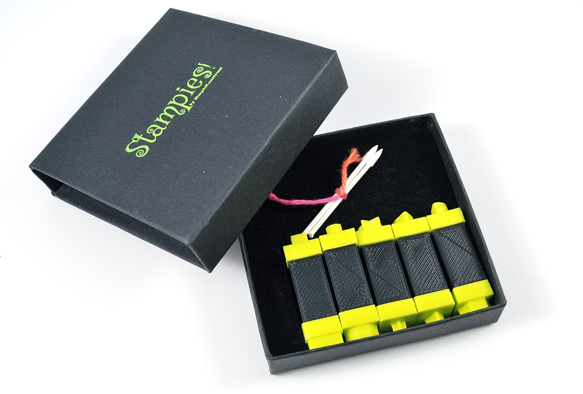 Stampies set come in a posh box with two little pointed swabs for cleaning them.