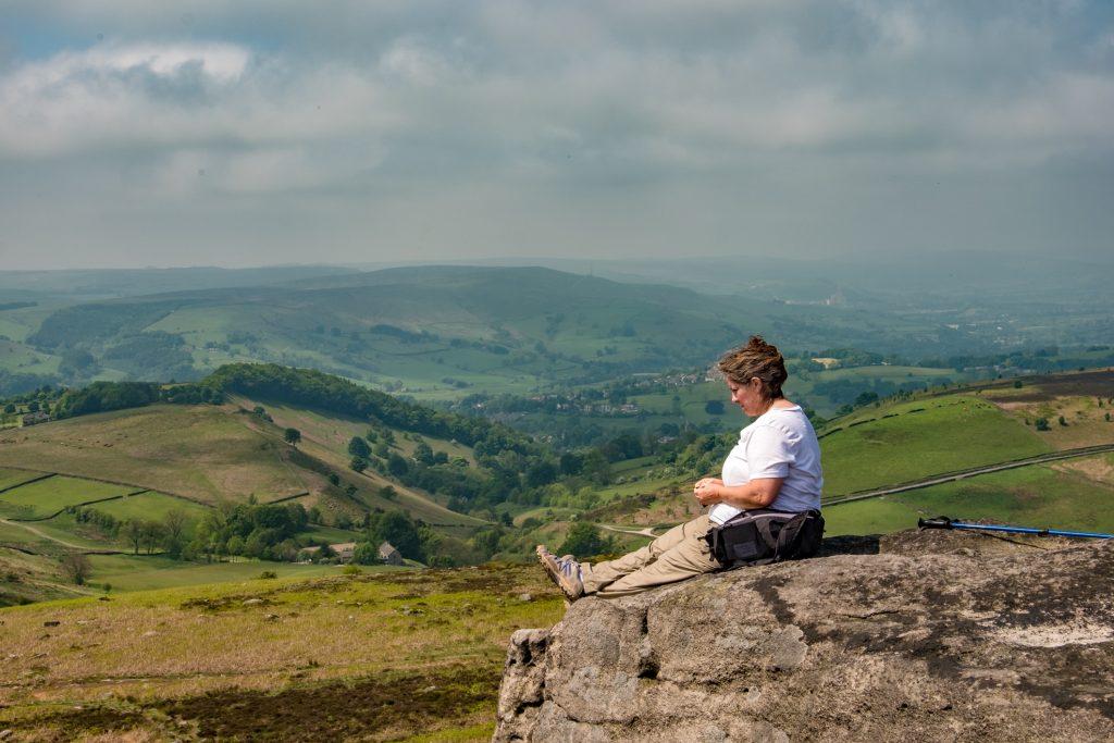 Ginger sitting on Higger Tor in the Peak District.