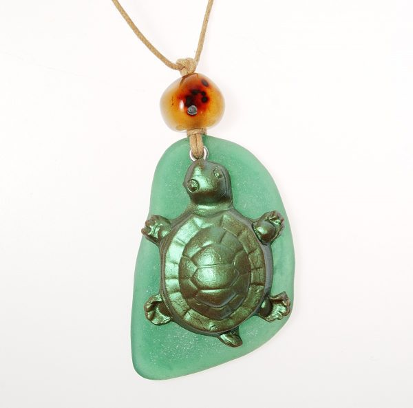 This turtle pendant is made from polymer clay and yes, that is polymer clay faux sea glass!