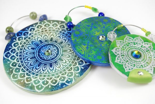Beautiful Opulent Tapestry pendants made from polymer clay with the tutorial from The Blue Bottle Tree.
