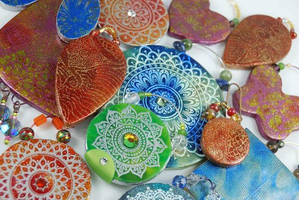 Opulent tapestry pendants and ornaments made from polymer clay using silkscreens. Tutorial at The Blue Bottle Tree.