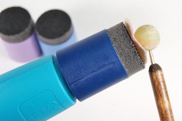 You can sand round beads with the Poly-Fast by using the padded heads and folding your sandpaper before use.