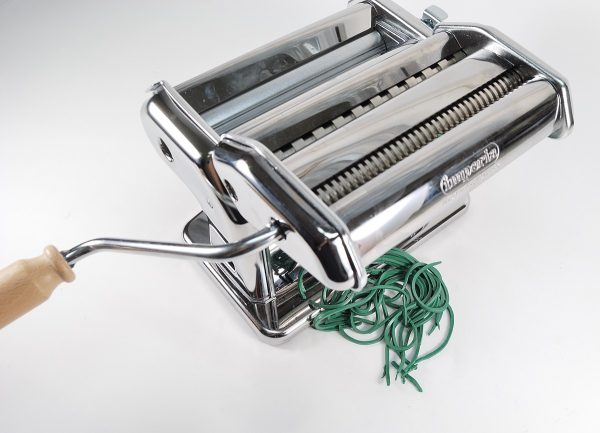 Imperia pasta machine with cutter attachment, being used to make thin strips of polymer clay.