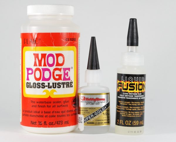 Glues can sometimes be used to create a clear-coat finish that can be applied to polymer clay.