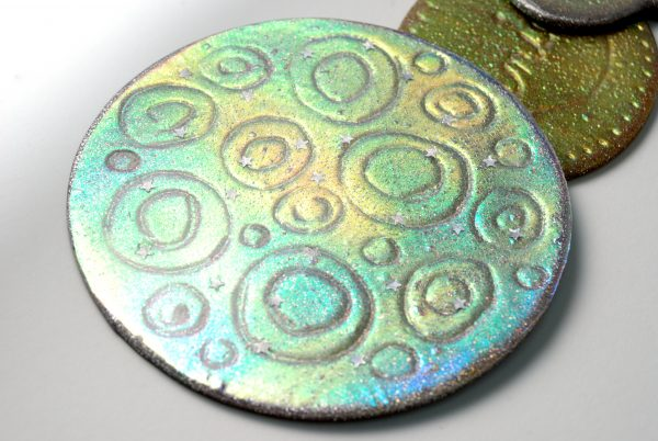 You can make Holo Effect Cutter Ornaments in polymer clay with the Holo Effect Tutorial from The Blue Bottle Tree.