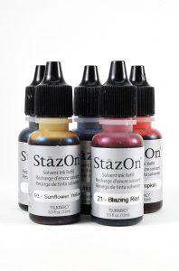 StazOn stamp pads are solvent based dyes, similar to alcohol inks. You can use the re-inkers in the same way as alcohol inks.