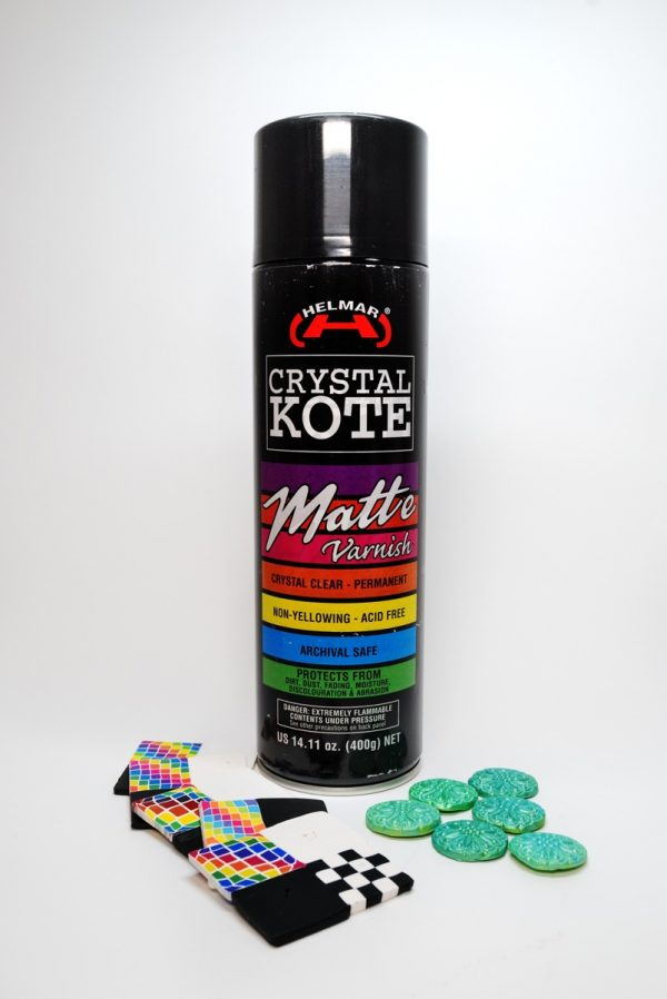 Helmar Crystal Kote is an excellent spray varnish for polymer clay. The matte version is invisible.